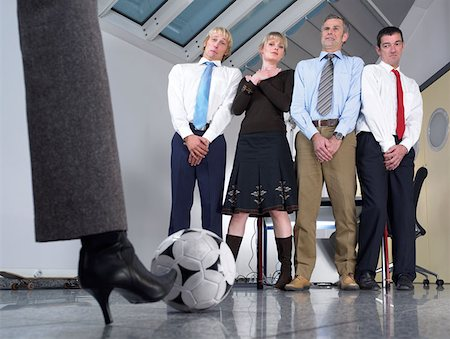 female crotch - Kicking football at colleagues Stock Photo - Premium Royalty-Free, Code: 614-00844334