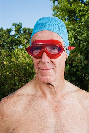 Senior adult man wearing swimming goggles Stock Photo - Premium Royalty-Free, Code: 614-00892274