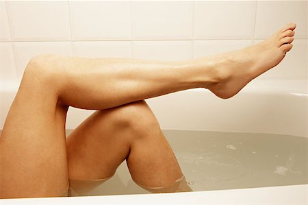 Legs of woman in the bath Stock Photo - Premium Royalty-Free, Code: 614-00913255