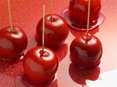 red stick candy - Toffee apples Stock Photo - Premium Royalty-Free, Code: 614-00944680