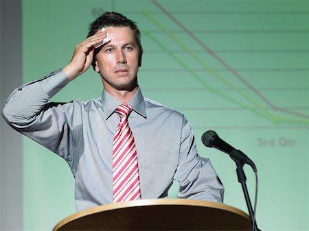 sweaty businessman - Businessman giving a speech Stock Photo - Premium Royalty-Free, Code: 614-00943258