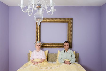 Couple in bed looking miserable Stock Photo - Premium Royalty-Free, Code: 614-01028139