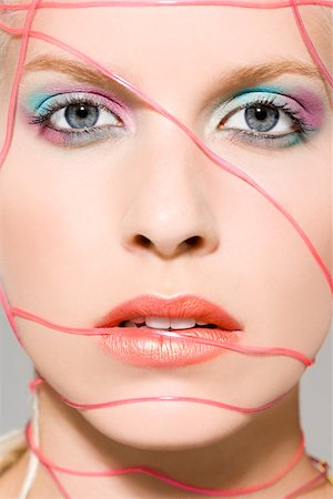 Woman with cables across her face Stock Photo - Premium Royalty-Free, Code: 614-01088523