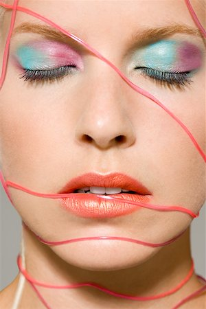 Woman with cables across her face Stock Photo - Premium Royalty-Free, Code: 614-01088599