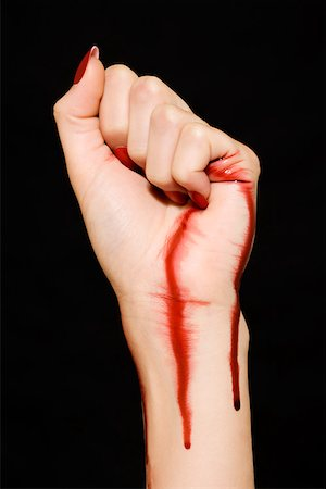 dripping blood - Woman with blood on her hand and wrist Stock Photo - Premium Royalty-Free, Code: 614-01088617