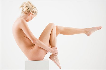 Nude woman sitting on a box Stock Photo - Premium Royalty-Free, Code: 614-01179400