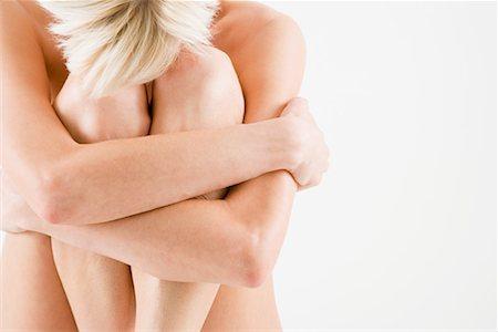 Nude woman hugging her legs Stock Photo - Premium Royalty-Free, Code: 614-01179441