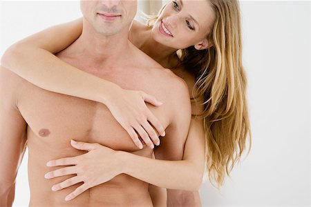 Woman touching mans chest Stock Photo - Premium Royalty-Free, Code: 614-01433029