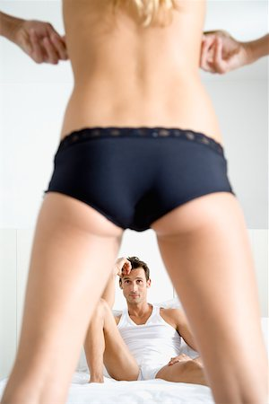 Man watching woman undress Stock Photo - Premium Royalty-Free, Code: 614-01433069