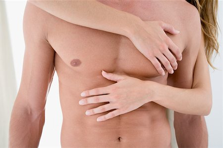 Female hands in male chest Stock Photo - Premium Royalty-Free, Code: 614-01433097