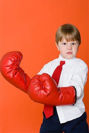 Boy wearing boxing gloves Stock Photo - Premium Royalty-Free, Code: 614-01559138