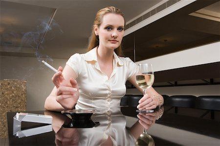Woman smoking and drinking Stock Photo - Premium Royalty-Free, Code: 614-01820782