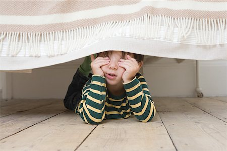 Boy playing hide and seek Stock Photo - Premium Royalty-Free, Code: 614-01821687