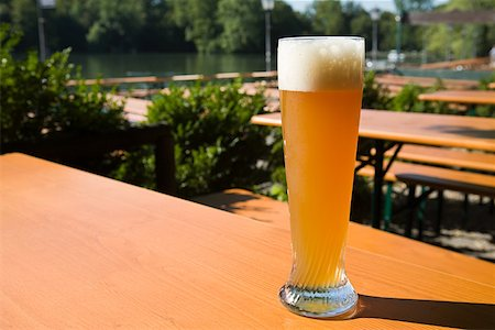 A glass of wheat beer in a german beer garden Stock Photo - Premium Royalty-Free, Code: 614-01821785