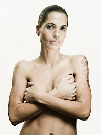 Woman covering her breasts Stock Photo - Premium Royalty-Free, Code: 614-01869831