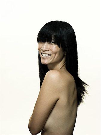 Nude woman smiling Stock Photo - Premium Royalty-Free, Code: 614-01869904