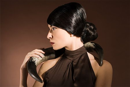 Young woman with animal horn Stock Photo - Premium Royalty-Free, Code: 614-02003810