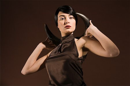 Young woman with animal horn Stock Photo - Premium Royalty-Free, Code: 614-02003820