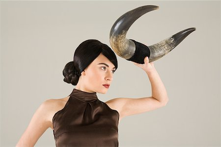 Young woman with animal horn Stock Photo - Premium Royalty-Free, Code: 614-02003823