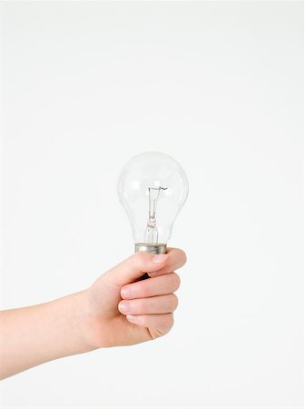 Child holding a lightbulb Stock Photo - Premium Royalty-Free, Code: 614-02050255