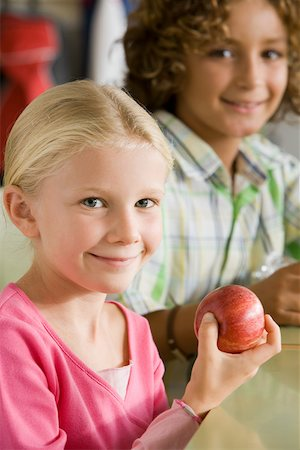 A girl holding an apple Stock Photo - Premium Royalty-Free, Code: 614-02050268