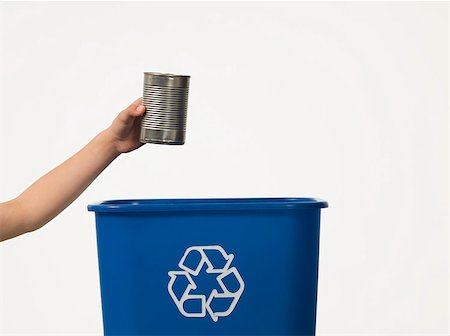 Boy recycling a tin can Stock Photo - Premium Royalty-Free, Code: 614-02050299
