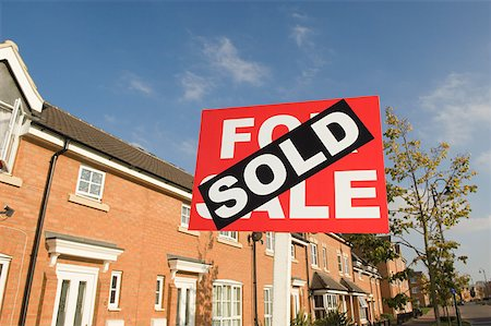 sold sign - Sold sign and houses Stock Photo - Premium Royalty-Free, Code: 614-02240600