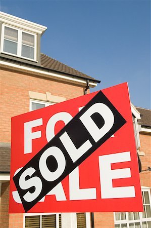 sold sign - Sold sign and house Stock Photo - Premium Royalty-Free, Code: 614-02240660