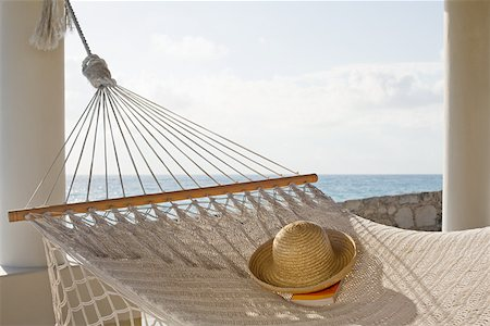 Hat and book on hammock Stock Photo - Premium Royalty-Free, Code: 614-02241328