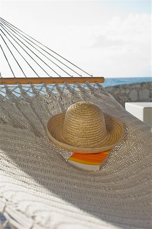 Hat and book on hammock Stock Photo - Premium Royalty-Free, Code: 614-02241329