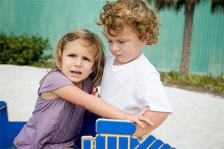 Sister and brother fighting Stock Photo - Premium Royalty-Free, Code: 614-02241485