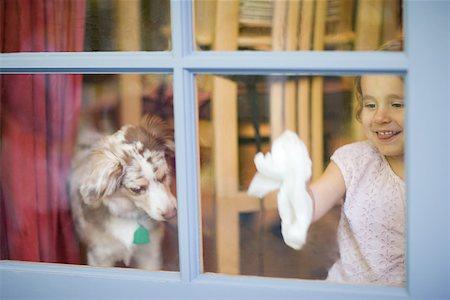 Girl cleaning window Stock Photo - Premium Royalty-Free, Code: 614-02241492
