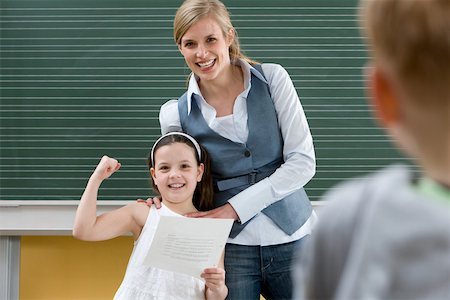 Teacher and girl in class Stock Photo - Premium Royalty-Free, Code: 614-02242480