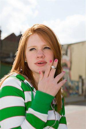Teenage girl smoking Stock Photo - Premium Royalty-Free, Code: 614-02243754