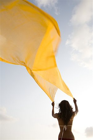 Woman with yellow cloth Stock Photo - Premium Royalty-Free, Code: 614-02259771