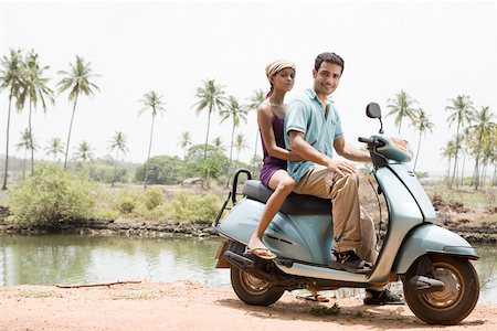 Couple on a moped Stock Photo - Premium Royalty-Free, Code: 614-02259772