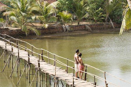 Couple on bridge Stock Photo - Premium Royalty-Free, Code: 614-02259814