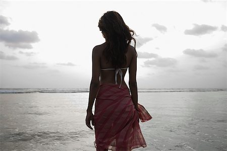 Young woman by the sea Stock Photo - Premium Royalty-Free, Code: 614-02259816