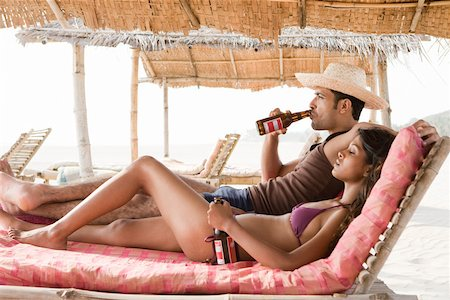 Couple drinking beer at beach Stock Photo - Premium Royalty-Free, Code: 614-02259818