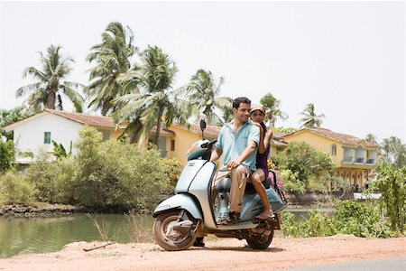 Couple on moped Stock Photo - Premium Royalty-Free, Code: 614-02259821