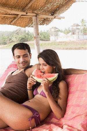 Couple on beach with watermelon Stock Photo - Premium Royalty-Free, Code: 614-02259843