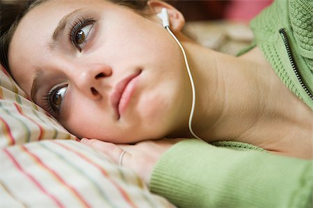 sad girls - A teenage girl listening to music Stock Photo - Premium Royalty-Free, Code: 614-02391899