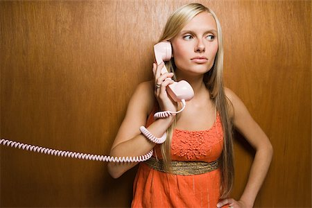 phone cord - Young woman on telephone Stock Photo - Premium Royalty-Free, Code: 614-02614081