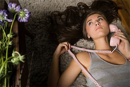 phone cord - Teenage girl with telephone Stock Photo - Premium Royalty-Free, Code: 614-02614124
