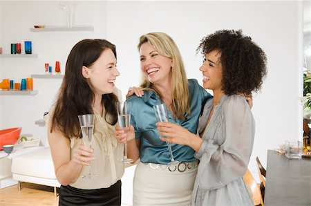 Friends talking at a dinner party Stock Photo - Premium Royalty-Free, Code: 614-02613378