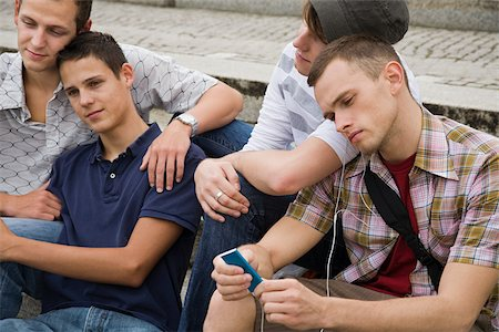 Friends sitting on steps Stock Photo - Premium Royalty-Free, Code: 614-02613430