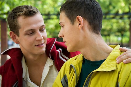 A gay couple looking at each other Stock Photo - Premium Royalty-Free, Code: 614-02613440