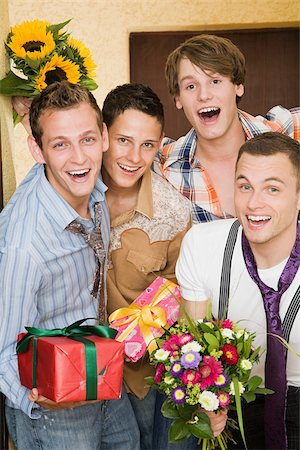 Portrait of friends with flowers and gifts Stock Photo - Premium Royalty-Free, Code: 614-02613484