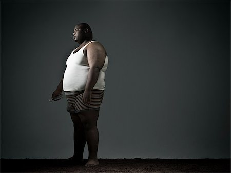 fat man full body - Overweight man in underwear watching tv Stock Photo - Premium Royalty-Free, Code: 614-02640163