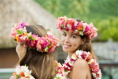 french polynesia - Young women with flowers in hair in moorea Stock Photo - Premium Royalty-Free, Code: 614-02679644